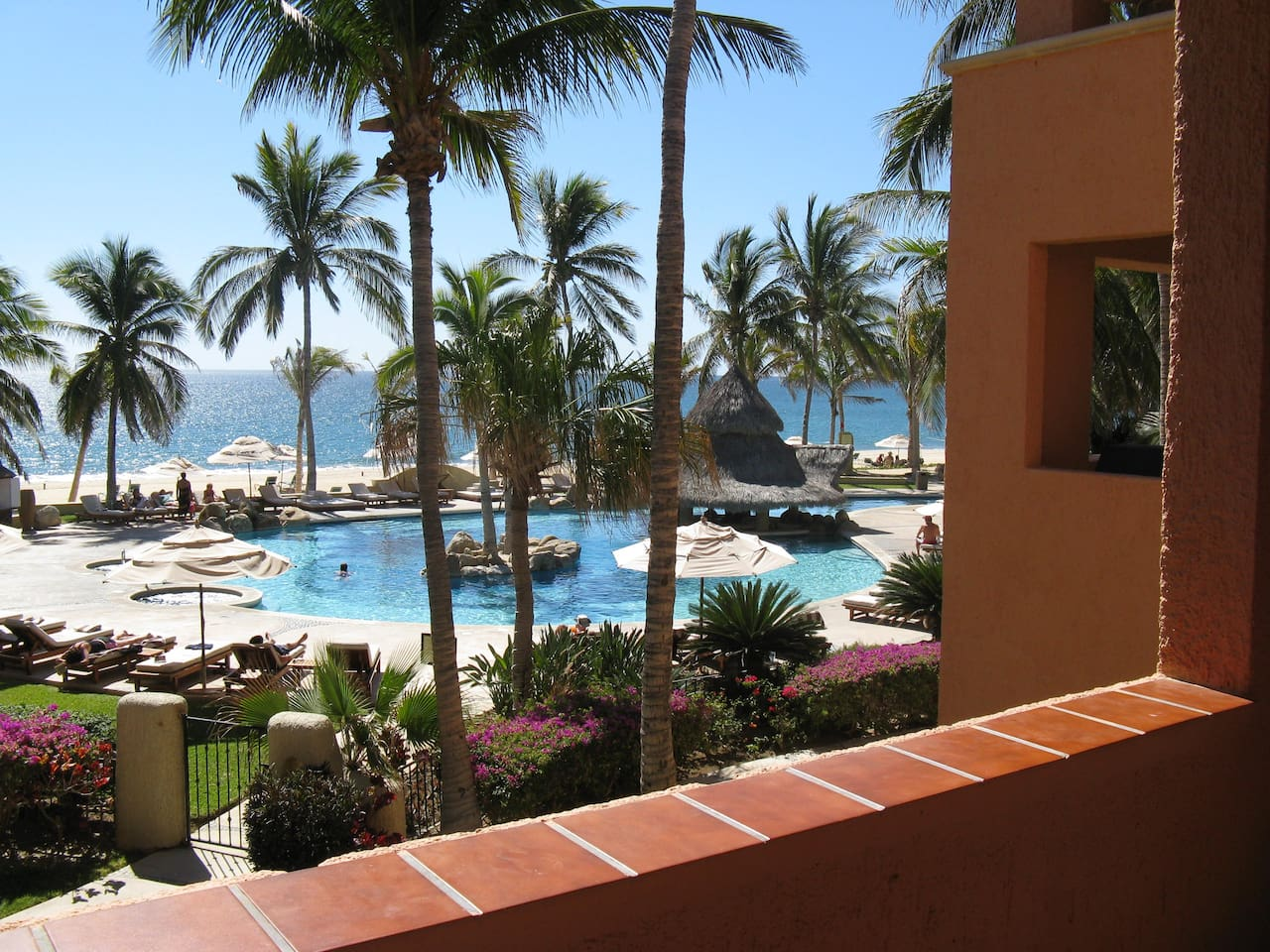 View from deck on to beautiful pool and steps to the beach