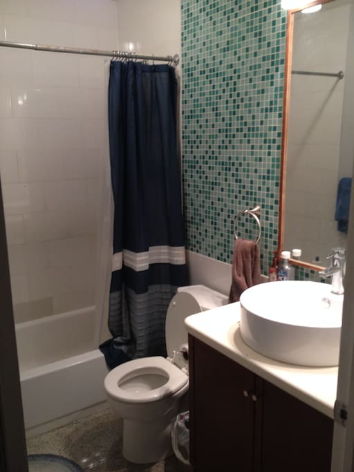 Bathroom shared with  2 people. Very spacious and lots of storage.