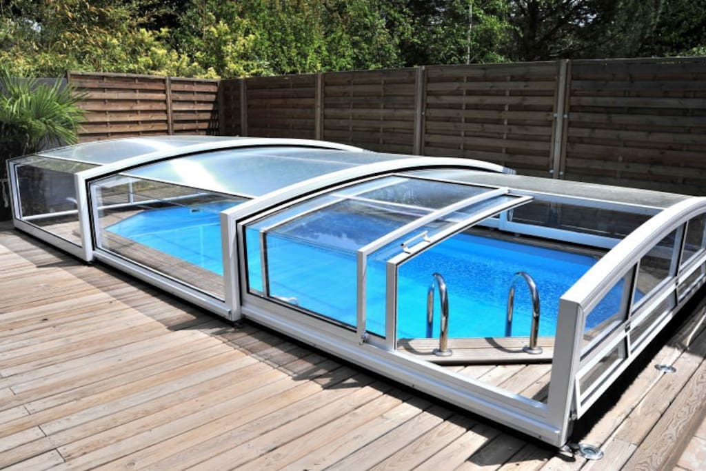 The pool with the telescopic pool enclosure (which can entirely slide off the pool)