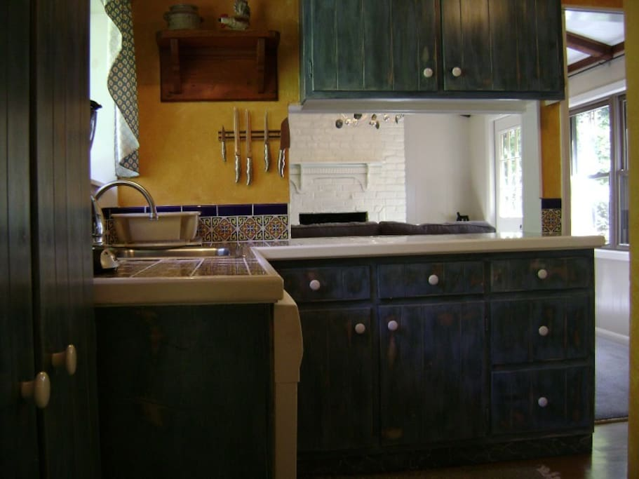 The kitchen looks into the TV room and is open for easy conversation while cooking or cleaning up.