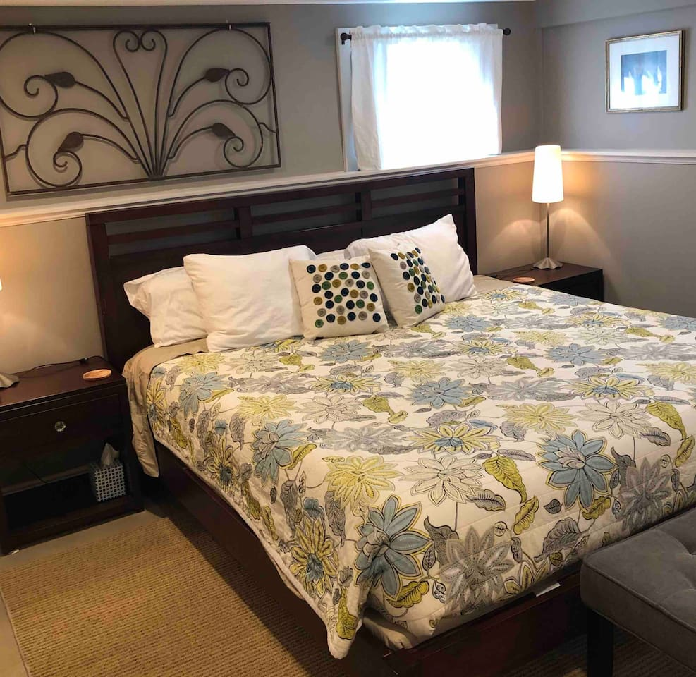 Large bedroom includes king size bed with organic cotton memory foam mattress