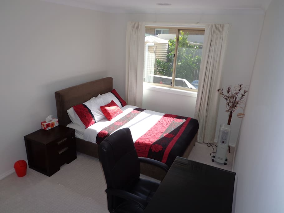Double bed and chair and table