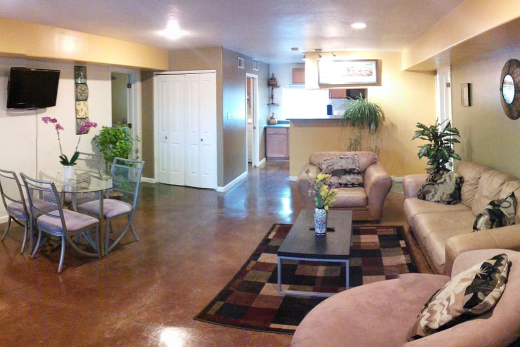 All rooms exit to this large common area furnished with comfortable leather couches and flat screen tv.