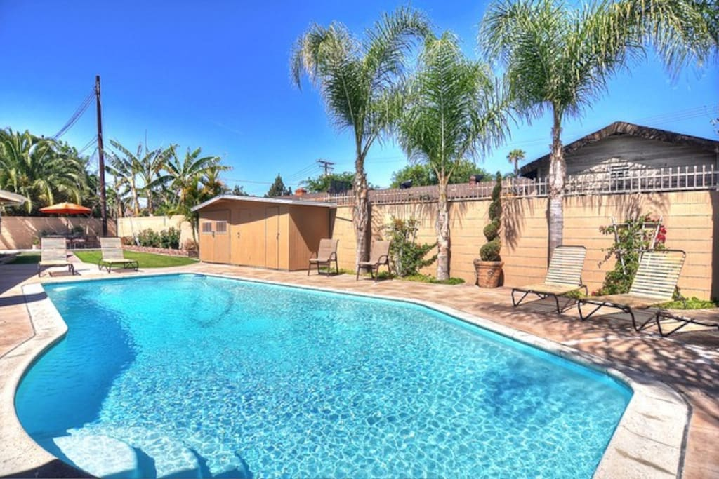 Plenty of lounge chairs, 2 large patio dining tables. Watch the fireworks at night while relaxing in the pool! 8 Burner gas BBQ grill!
