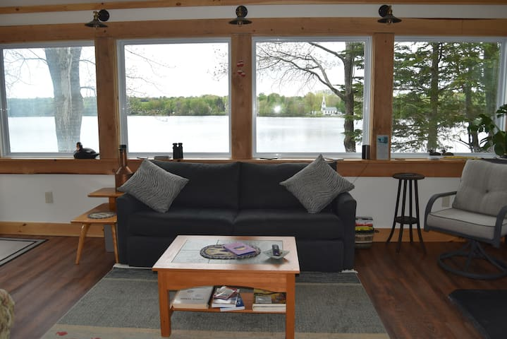 Living room with panoramic views of the lake