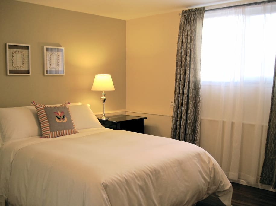 Bright bedroom with 100% Egyptian Cotton Sheets with down duvet