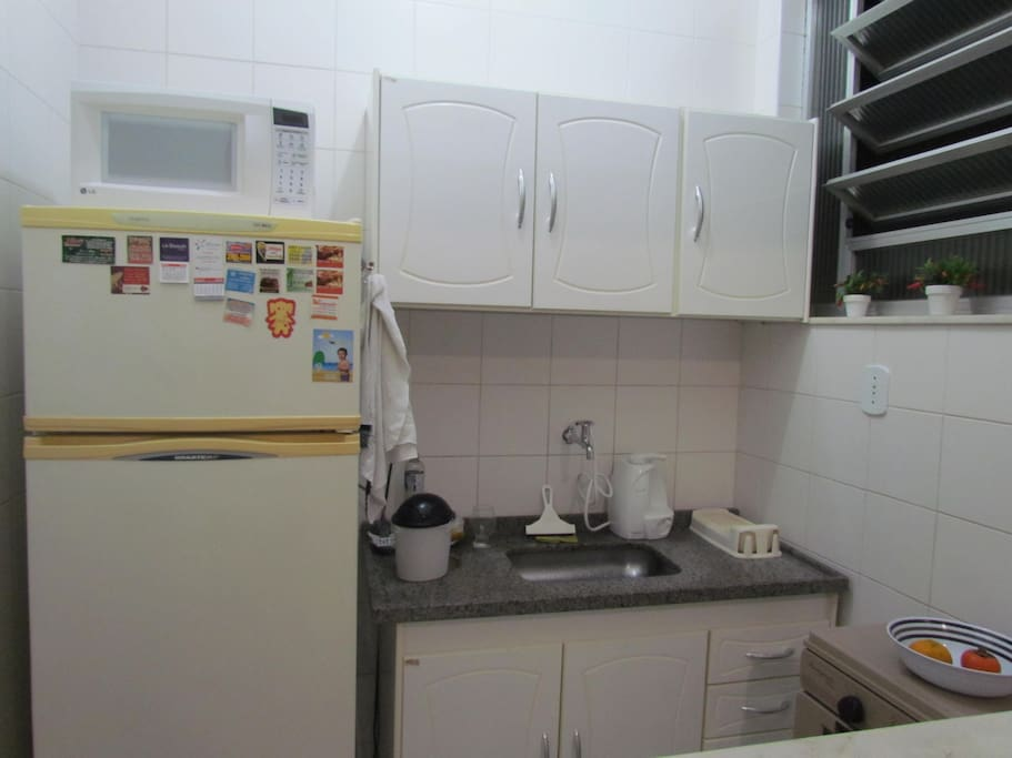 Refrigerator, microwave, stove and utensils gear.