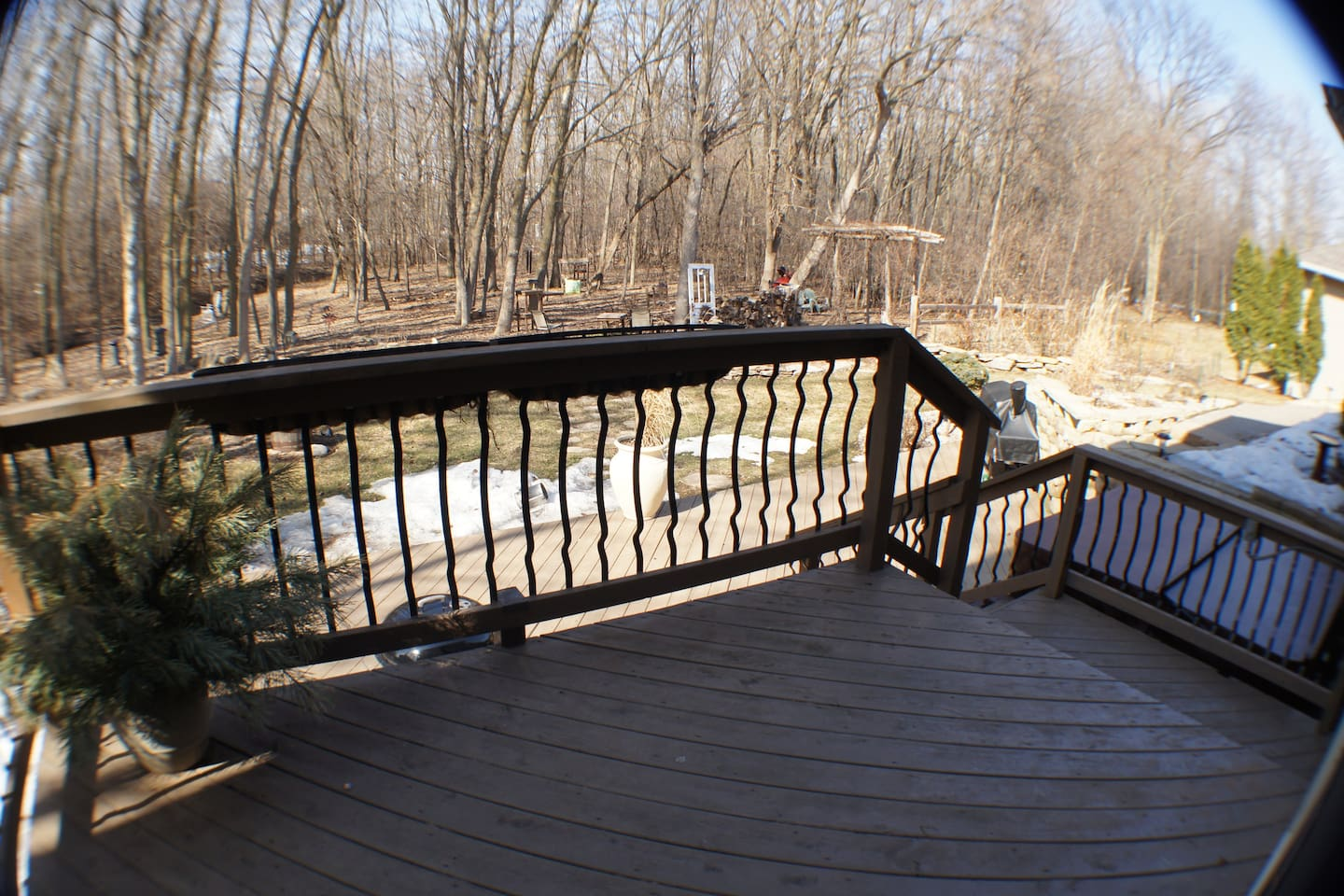 Winter Photo, large 2 tier deck, 8 person hot tub, outdoor fire pit and 1 acre wooded lot