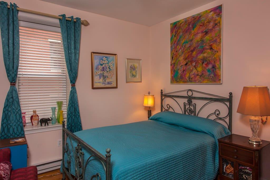 Quiet bedroom with queen rod iron bed