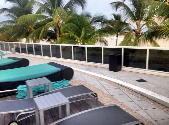 the swimming pool area overlooking the beach