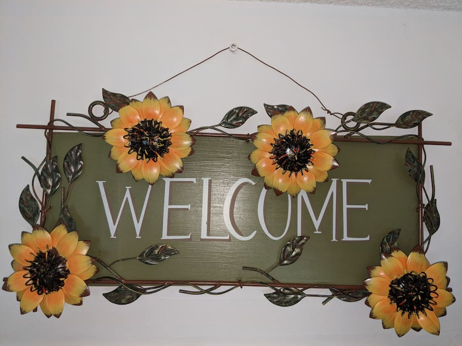 "Welcome to the ""Sunflower Room""."