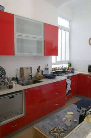 Kichen with dishwasher and microwave oven, etc.