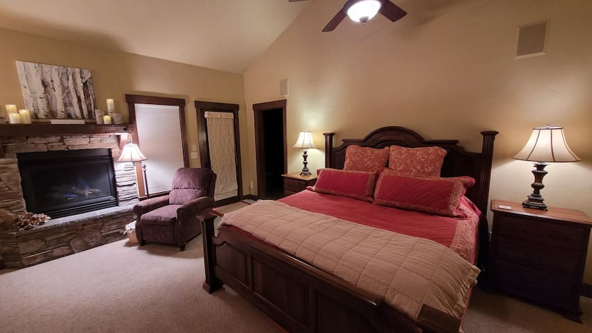 Master suite, King size bed, sitting area, fire place, HDTV, main floor, no steps to get to.