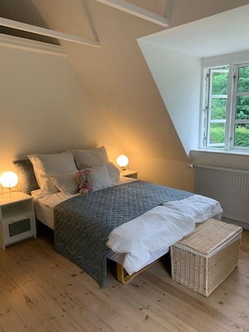 This is the largest of our guest rooms and can sleep 2-3 guests. There is a King size bed in the main room and a single bed in the attic room. The tea garden can be viewed from the french balcony. All the rooms have tea making facilities.