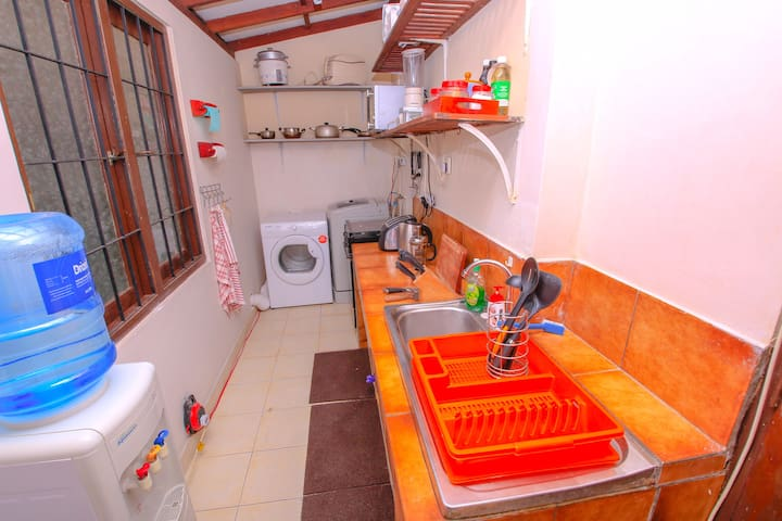 Fully equipped kitchen with utensils, appliances and plateware, and laundry facilities (Washer and Dryer)