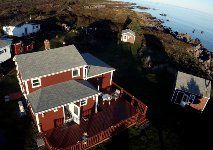 Heavenly! You will immediately enjoy the L-shape deck, located on a 35,514 sq. ft. at the end of a quiet street, bordering the stunning rocks and one of the 7 sand and pebbles beaches with lots of privacy