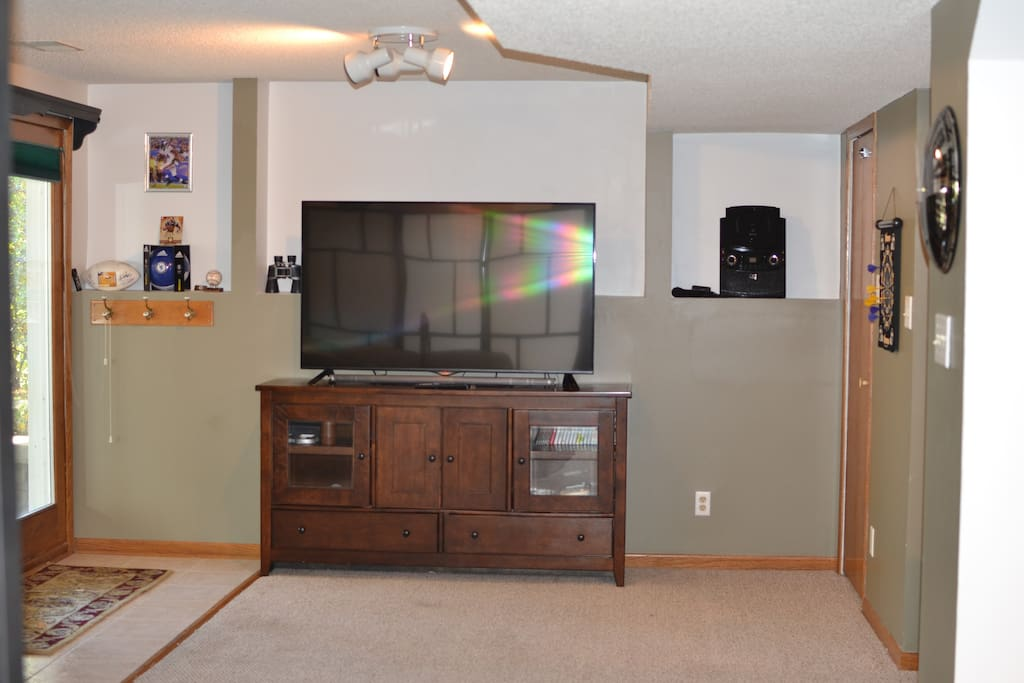 "60"" TV with Netflix access and Wii U console."