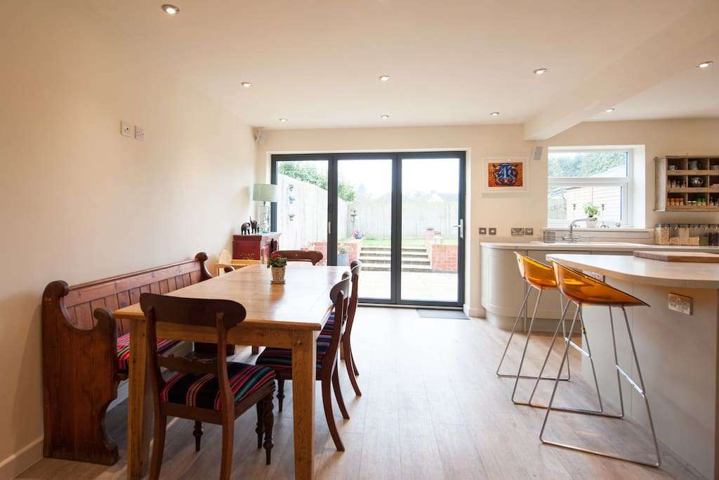 Kitchen with bifold doors onto back patio and garden area.