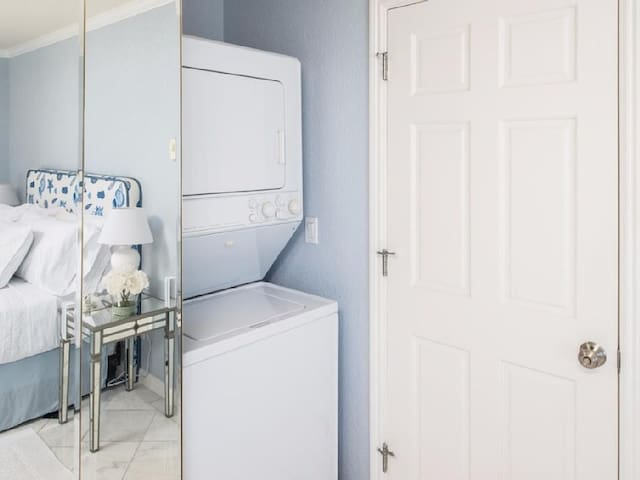 Washer and dryer is conveniently located in the master bedroom.