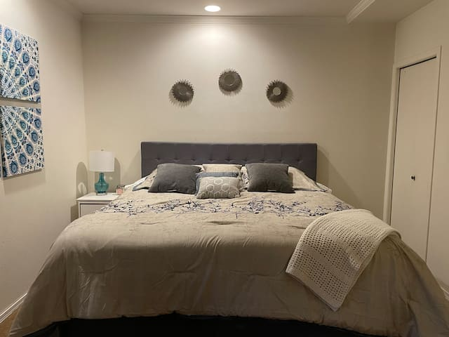 First bedroom with a king size bed, TV with DVD player (no cable) and a closet with dresser.
