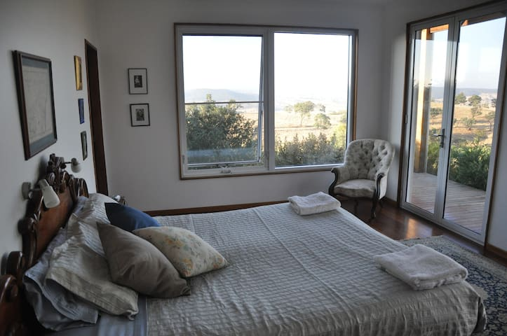 The master bedroom has views out to the West, a king size bed and ensuite.