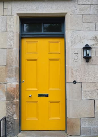 Look for the Yellow Door you can't miss us!