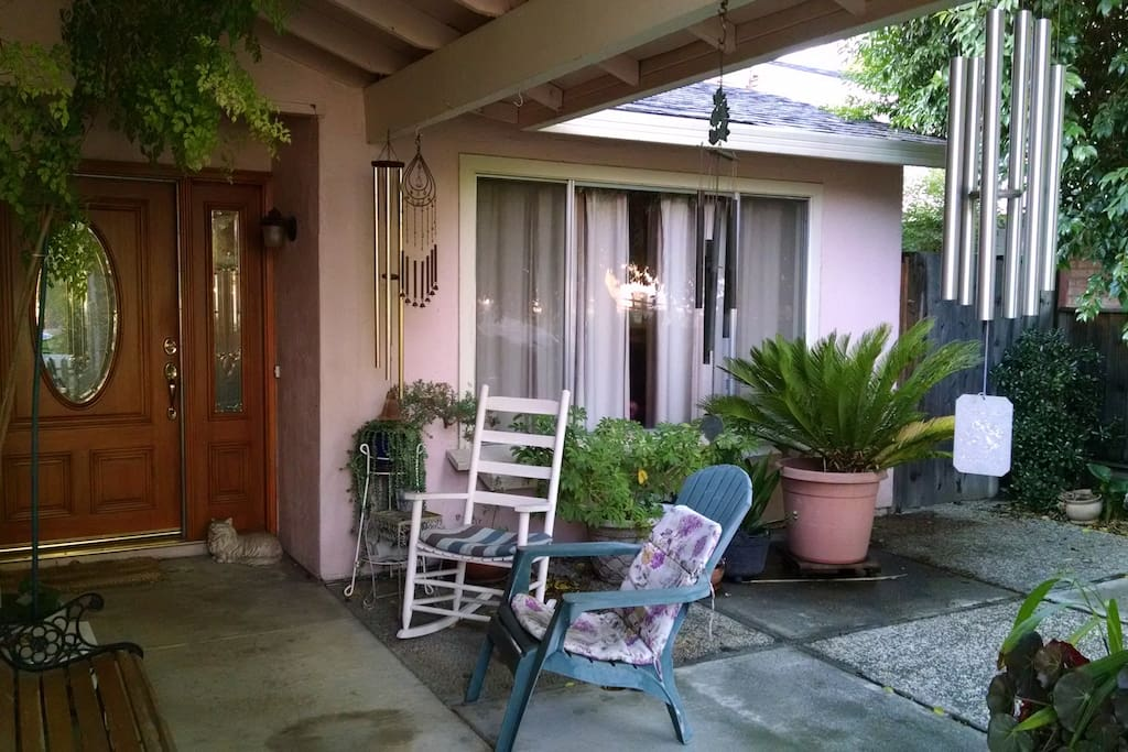 Quiet neighborhood, front porch sitting area.