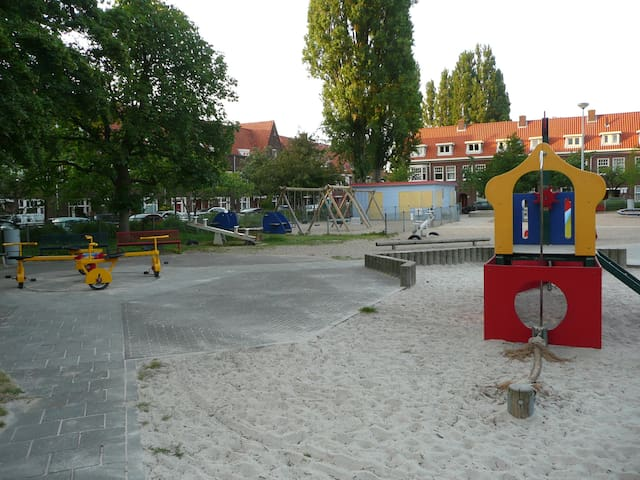 Large playground a cross the street.