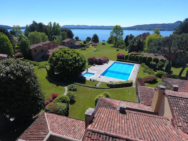 Waterfront with swimming pool, tennis and beach