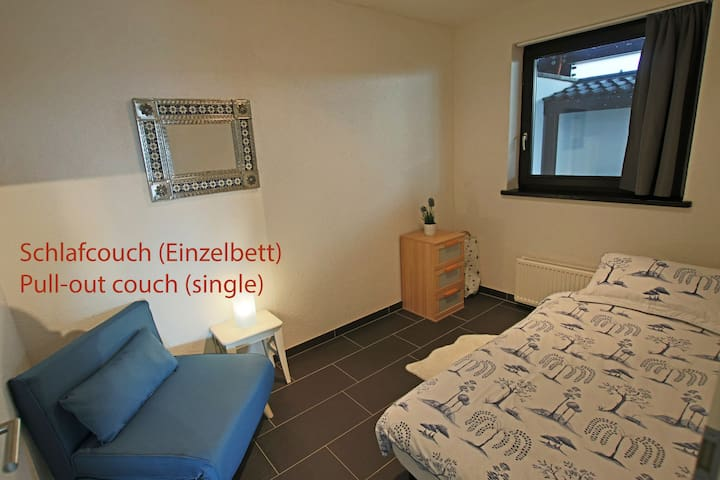 Single bed with pull-out couch.