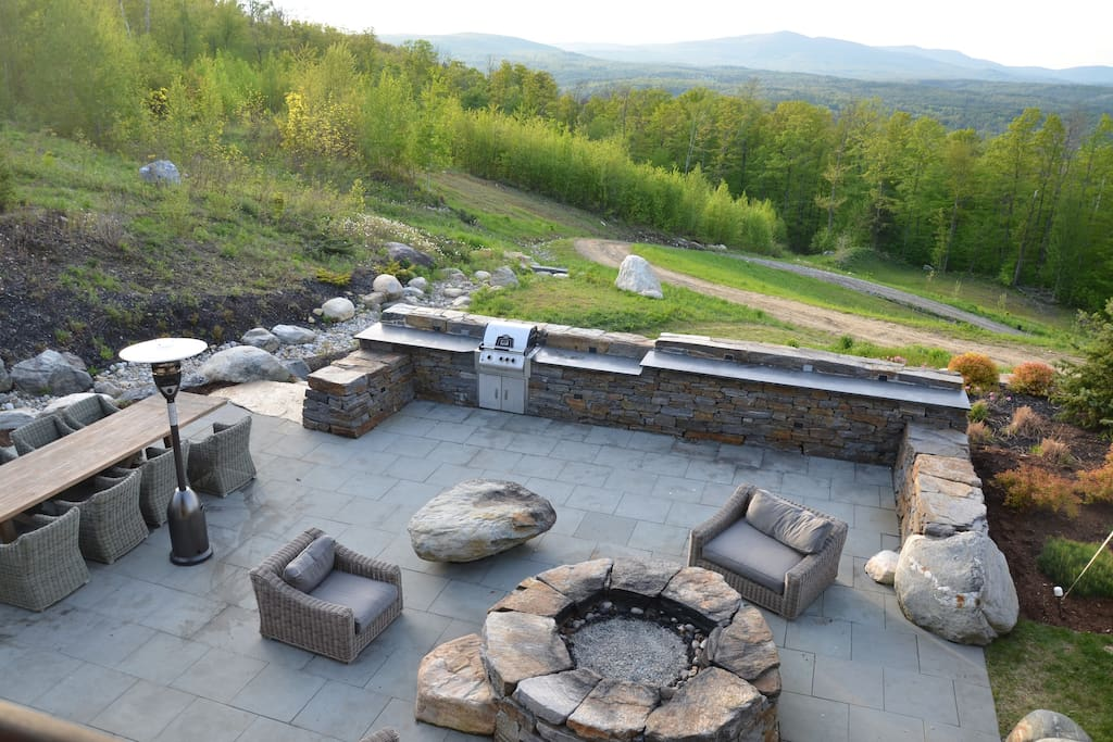 Outdoor patio with fire pit and view to Bromley Mountain