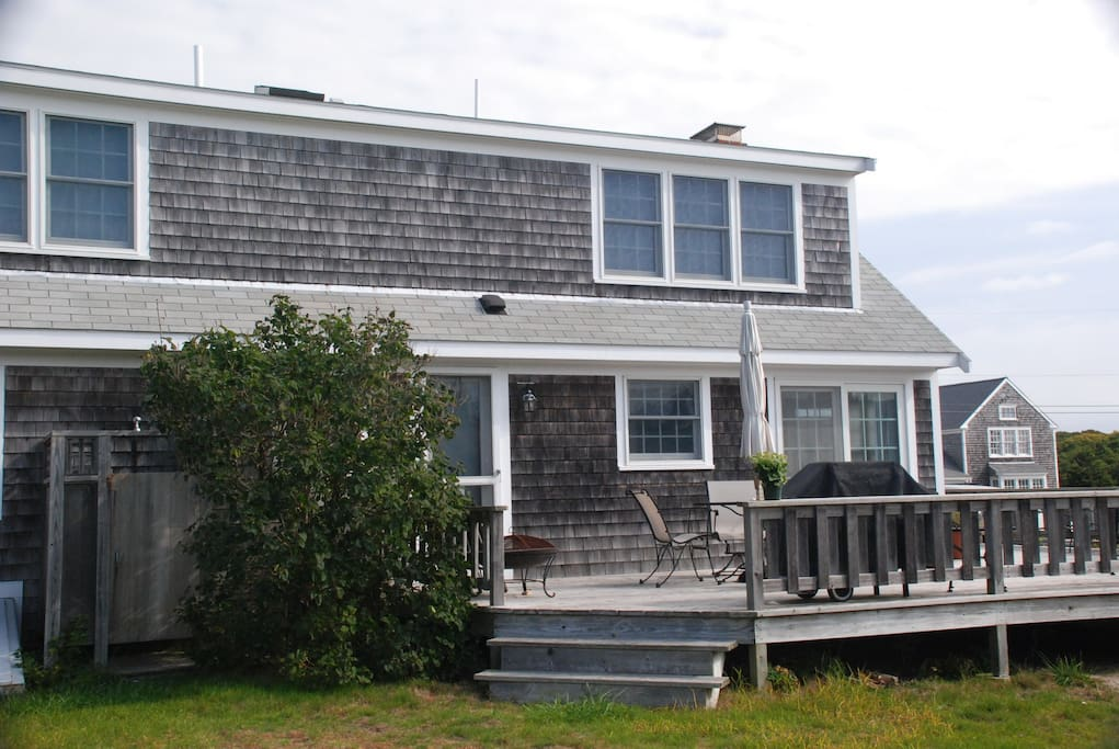 Shed roof in back gives full height second floor.  Large private deck off kitchen