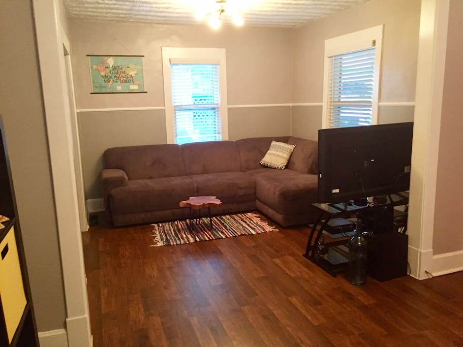 Living room with incredibly comfy couch, HDTV, DirecTV, and Roku player