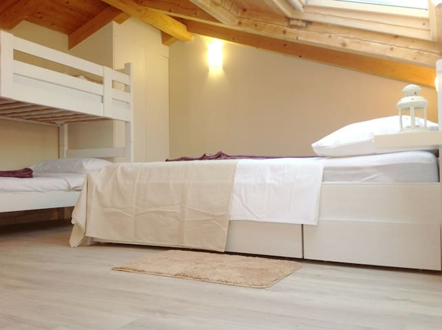 loft area with double bed and bunk bed