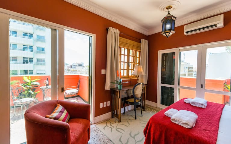 The Red Bedroom with Doors to Wrap-around Terrace