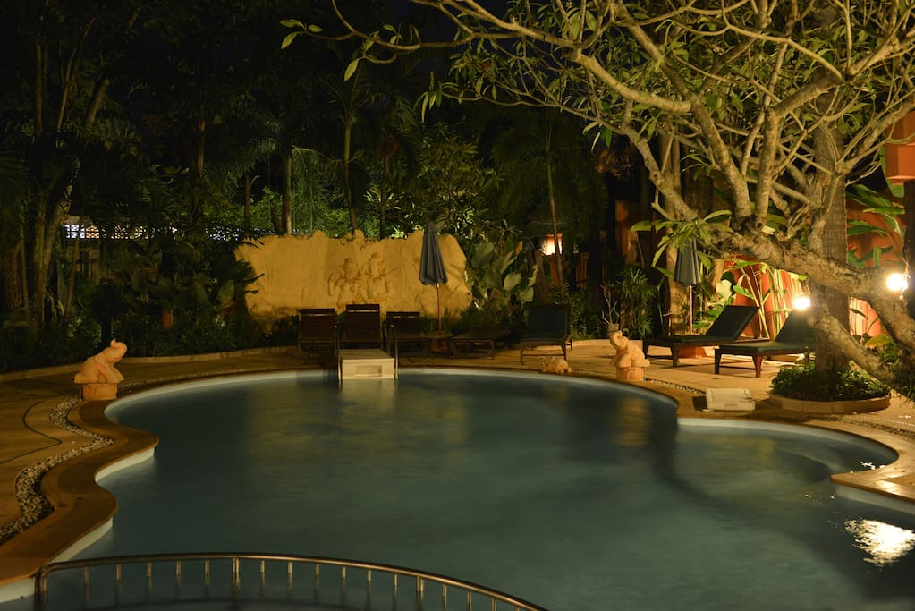 The pool, lit up at night for after-dark swims