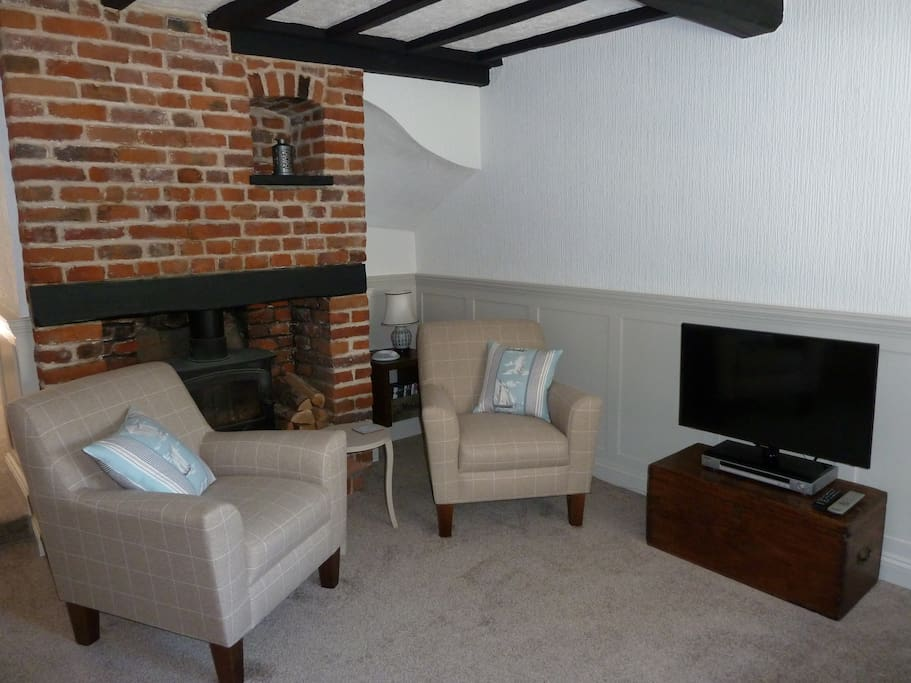 The comfortable living room with log burner