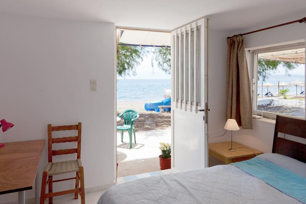 bedroom with double bed with view to the beach.