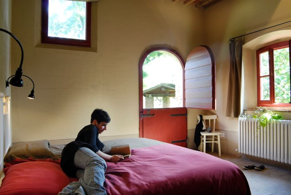 The bedroom with Dutch door that opens to the gardens