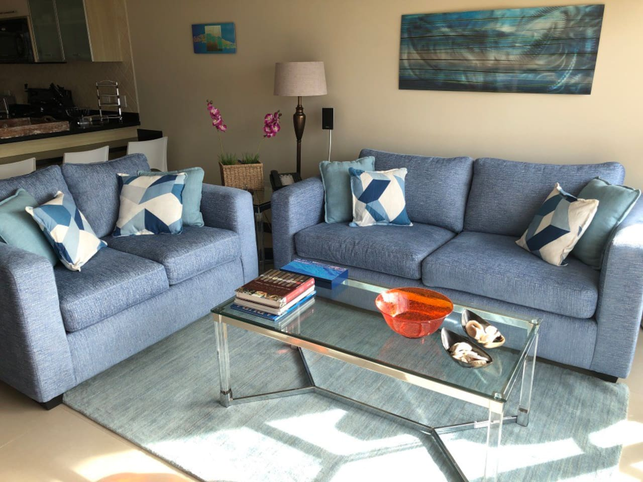 Comfy Blue color couches, one of them is a queen sofa bed