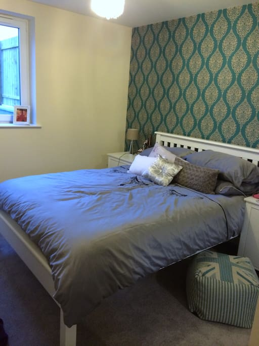 spacious double bedroom with large built in wardrobe and tv in bedroom