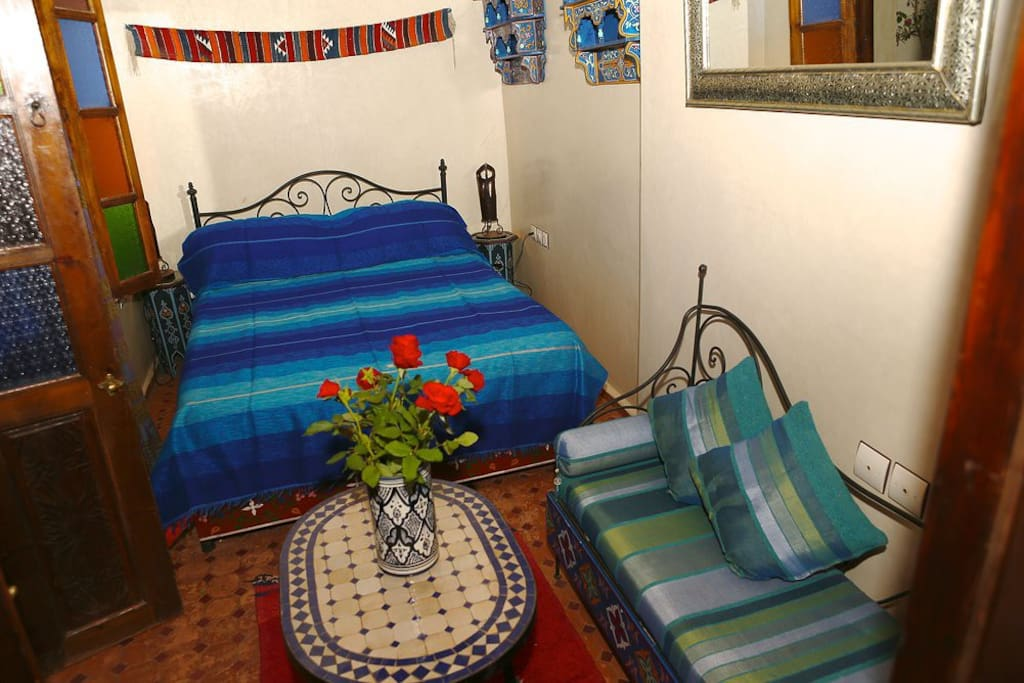 Essaouira double first floor en-suite bedroom with chaise lounge opening onto mezzanine level