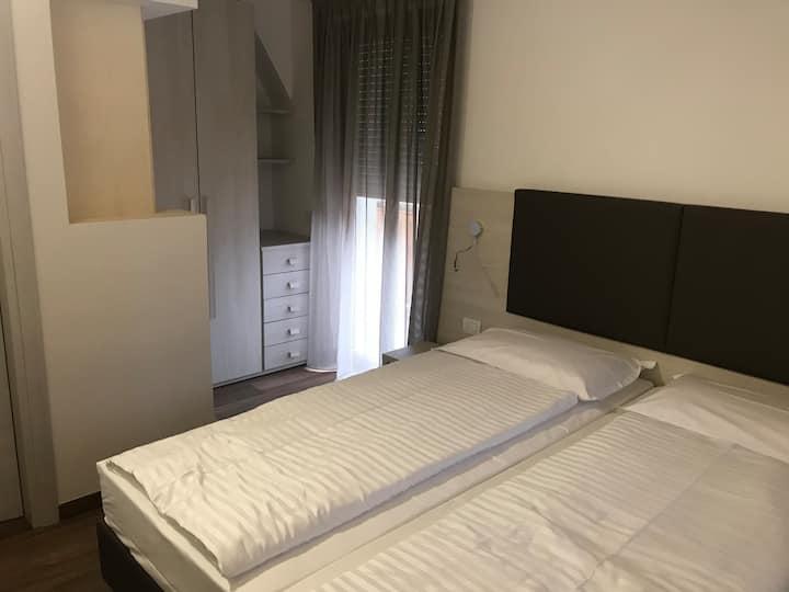 Camera indipendente privata con balcone e bagno