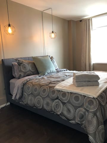 This bedroom is located off of the living room. It has a queen bed and large closet, as well as room darkening blinds. The heat is electric and each room has it's own thermostat.
