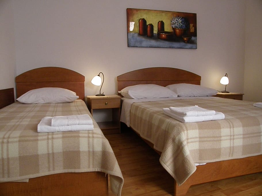 Bedroom with double bed and one single bed