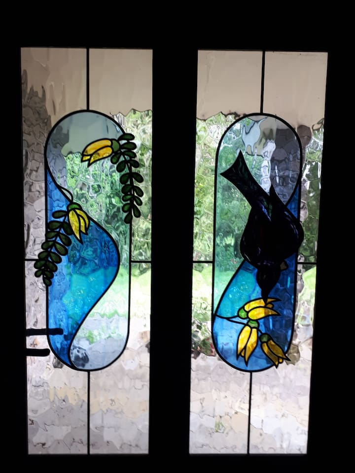 Our front door, during spring when the blossoms are out The Tui, Bellbirds and waxeyes fly in to feed off the nectar flowering trees.