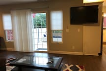 High def TV and patio in living room area