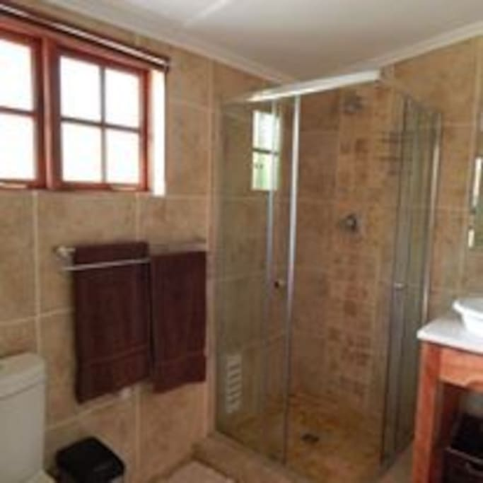 Underfloor heating and twin basins in bathroom.