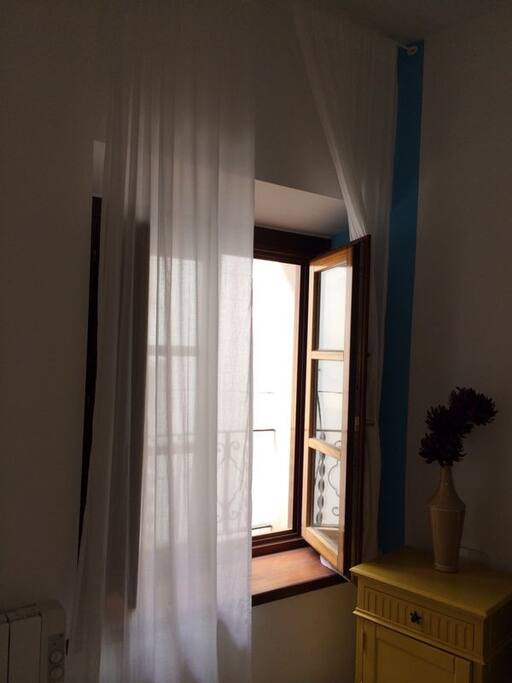 A window that goes to a quiet, charmy pedestrian street in the historic part of Sitges