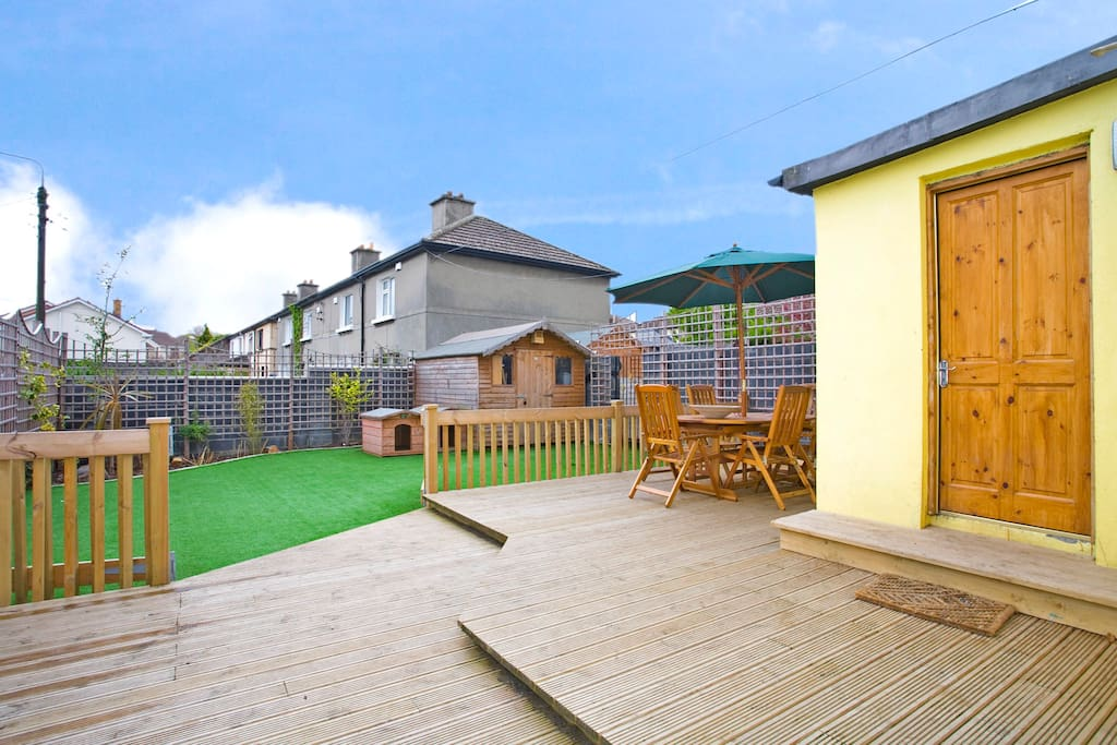 Back garden with large deck and and artificial lawn. (Garden furniture not included)